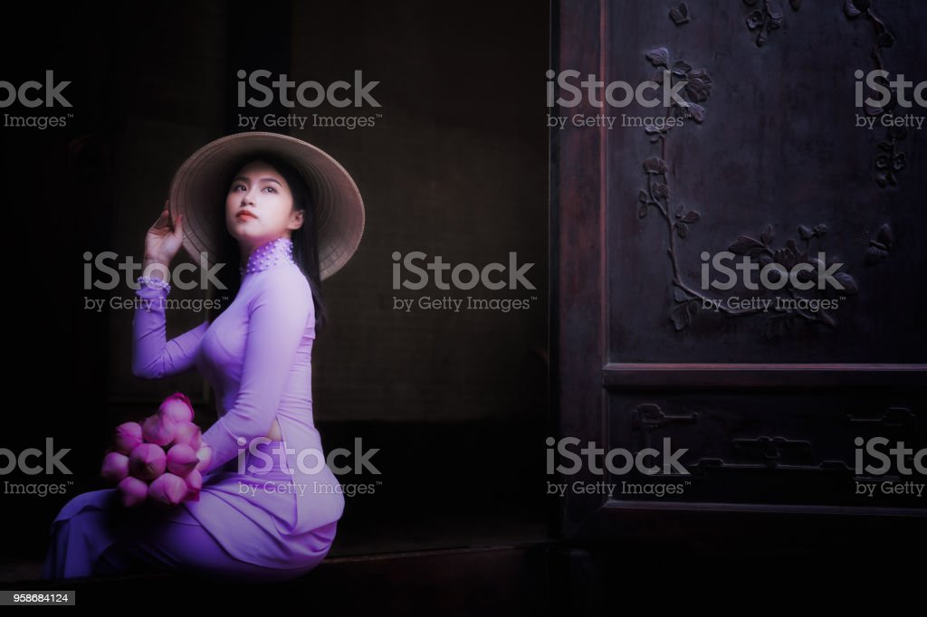 Vietnam woman wearing Ao Dai culture traditional. stock photo