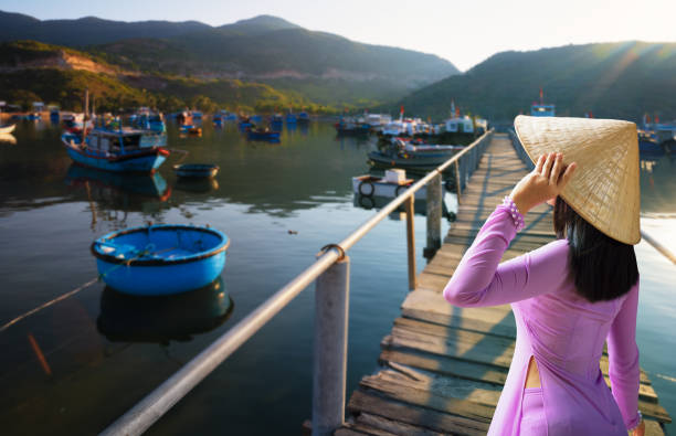 vietnam woman wearing ao dai culture traditional. - ao dai stock photos and pictures