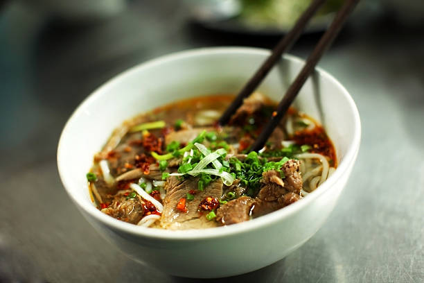 vietnamese beef noodle soup called pho - pho soup stock photos and pictures