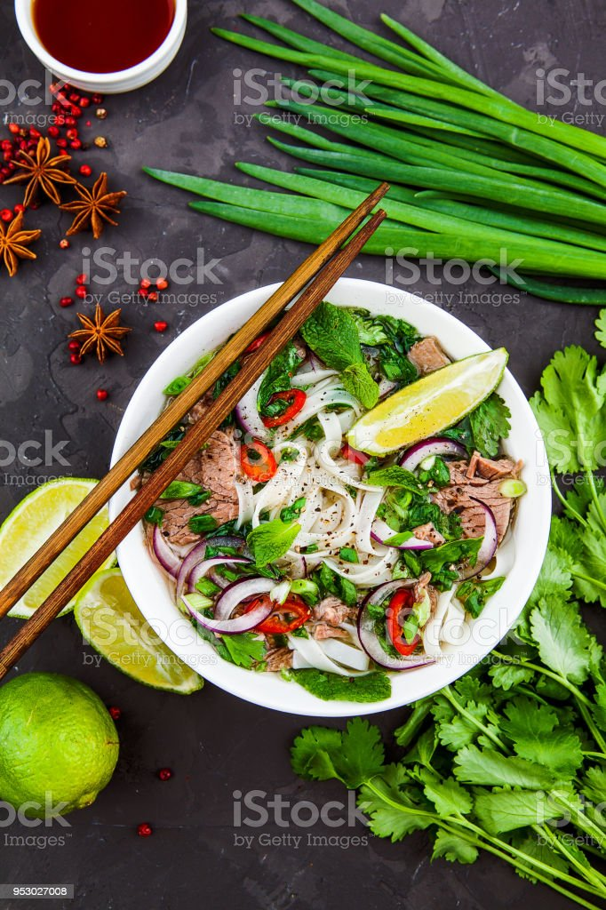 Vietnamese Beef Noodle Soup Pho Bo with beef on dark background stock photo
