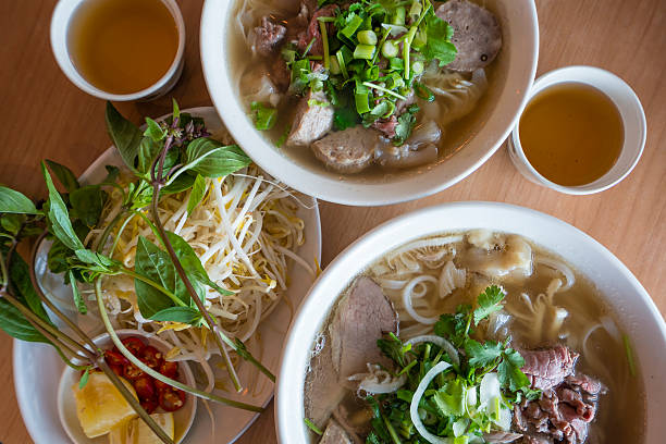 vietnamese beef noodle soup - pho soup stock photos and pictures