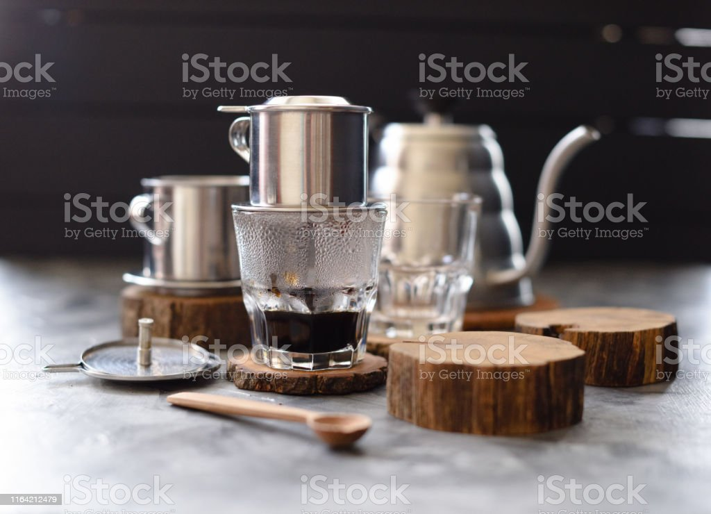 Vietnamese Black Drip Coffee Traditional Vietnamese Coffee Maker Phin And Goose Neck Kettle On Wood Slabs On Dark Background Stock Photo Download Image Now Istock