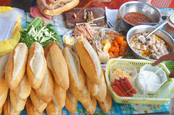 Vietnamese bread stall with lot of stuffed things Very tasty bánh mì sandwich stock pictures, royalty-free photos & images