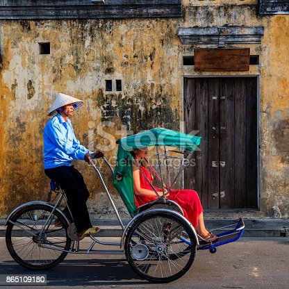 istock Vietnamese cycle rickshaw in old town in Hoi An city, Vietnam 865109180