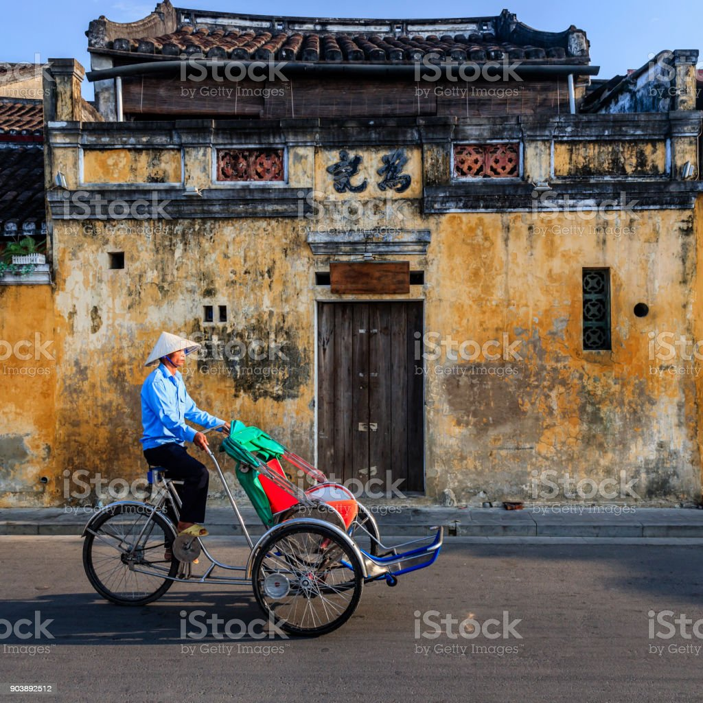 Vietnamese cycle rickshaw in old town in Hoi An city, Vietnam stock photo