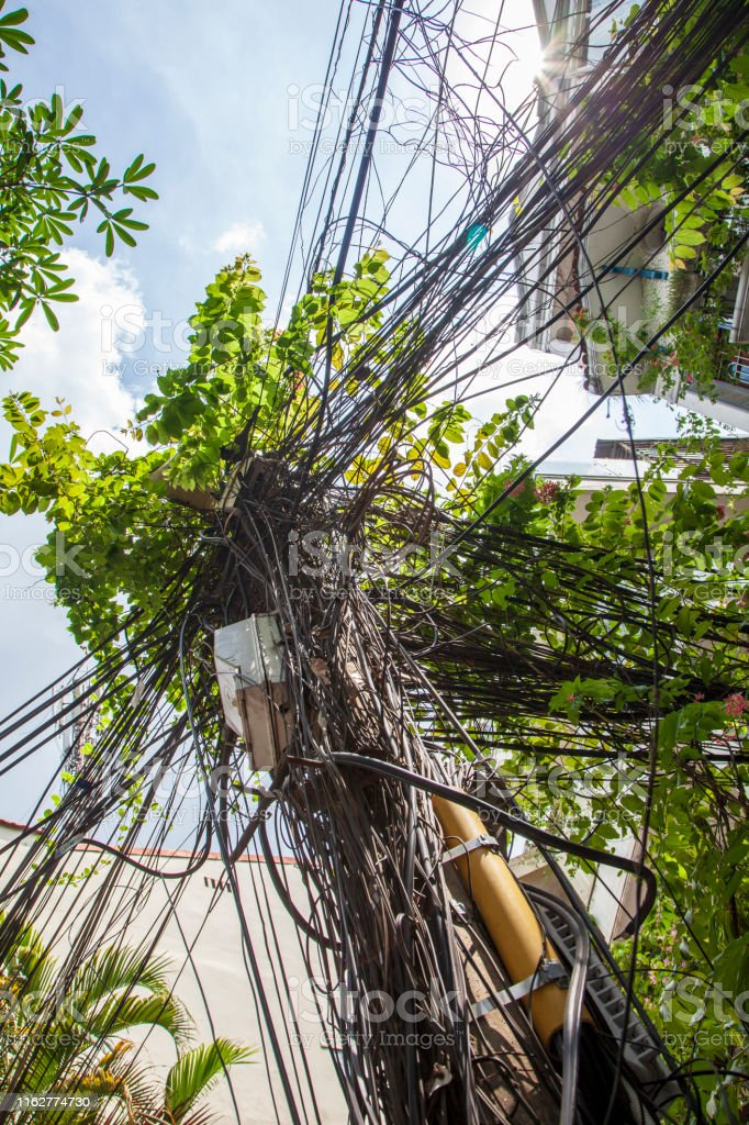 Vietnamese electrical networks. Electrical wires on poles in Hanoi.