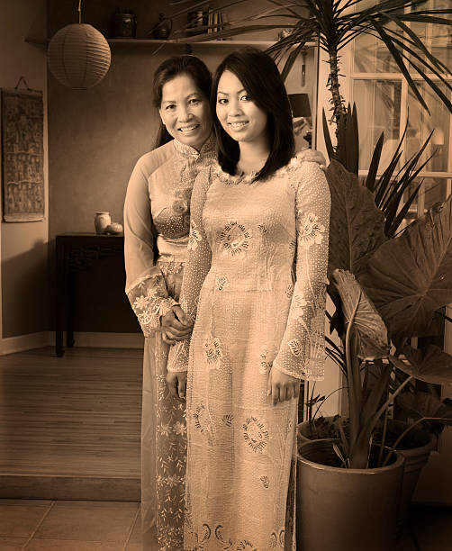 vietnamese family - mother and daughter - ao dai stock photos and pictures