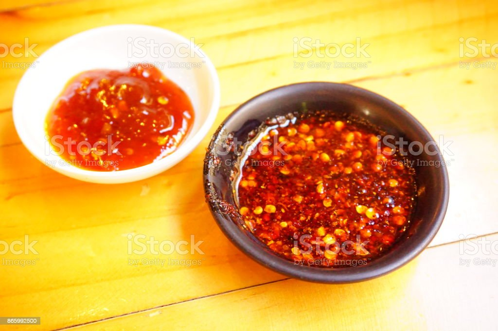 Vietnamese fish sauce with red hot chilli stock photo