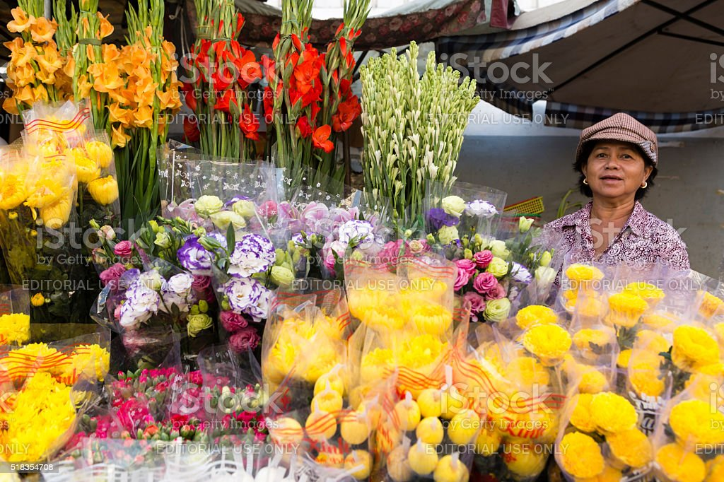 Vietnamese Flower Market Vendor stock photo