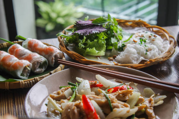 Vietnamese food arranged on table Vietnamese food arranged on table vietnamese culture stock pictures, royalty-free photos & images