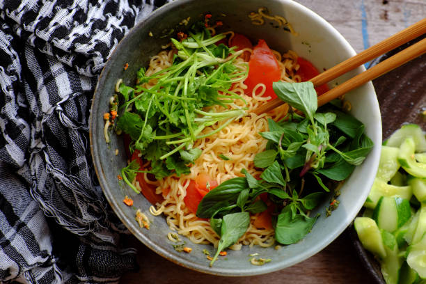 Vietnamese food, vegan instant noodles soup with tomato, quick meal for breakfast stock photo