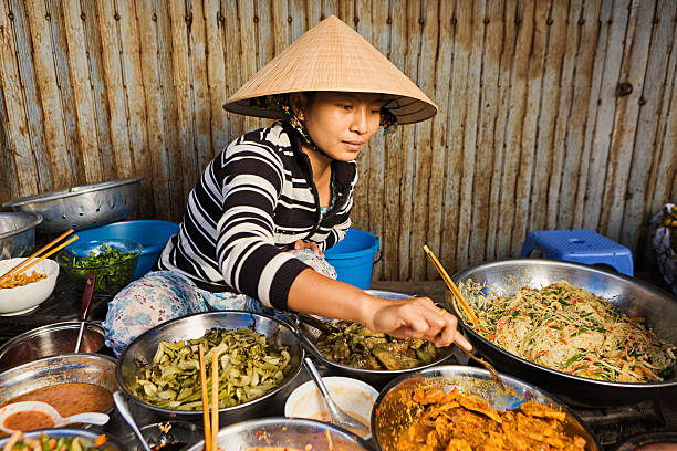 Vietnamese food vendor on local market  vietnamese culture stock pictures, royalty-free photos & images