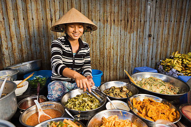 Vietnamese food vendor on local market  market vendor stock pictures, royalty-free photos & images