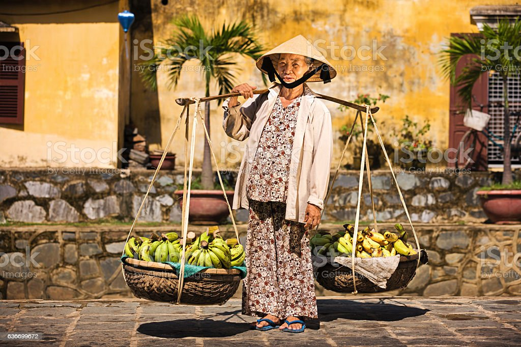 Vietnamese fruit seller stock photo