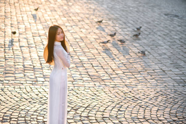 vietnamese girl dressed ao dai white dress. vietnamese traditional dress. - ao dai stock photos and pictures