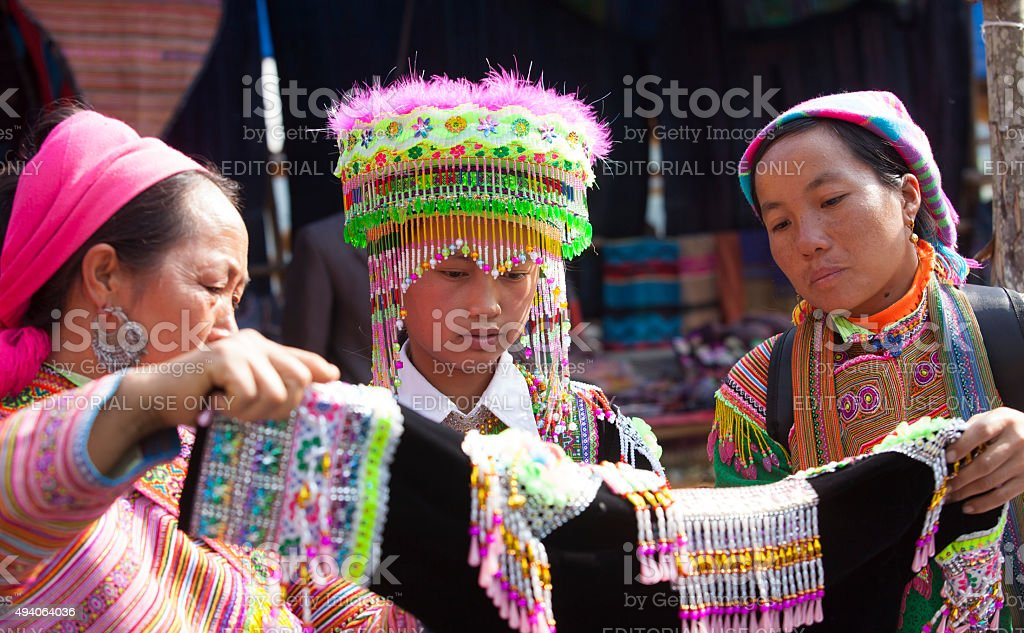 Vietnamese Hmong minority girl trying new traditional costume stock photo