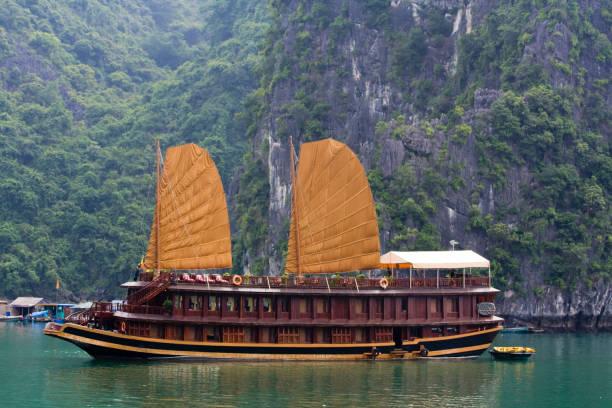 Vietnamese Junk cruising on Halong Bay, Hanoi, Vietnam stock photo