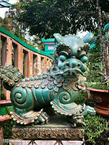 ornate national style sculpture in a green garden, Ho Chi Minh City