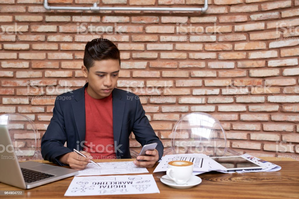 Vietnamese Manager Finishing Project royalty-free stock photo