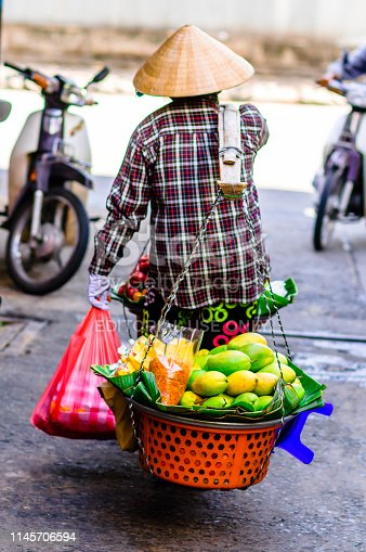30th October 2013: View on Vietnamese market trader balance food in Hanoi