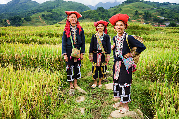 Vietnamese minority people - women from Red Dao hill tribe Red Dao women usually wear a long blouse over trousers and traditional red hat. taoism stock pictures, royalty-free photos & images