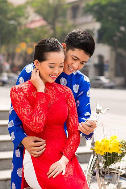vietnamese modern life - ao dai stock photos and pictures