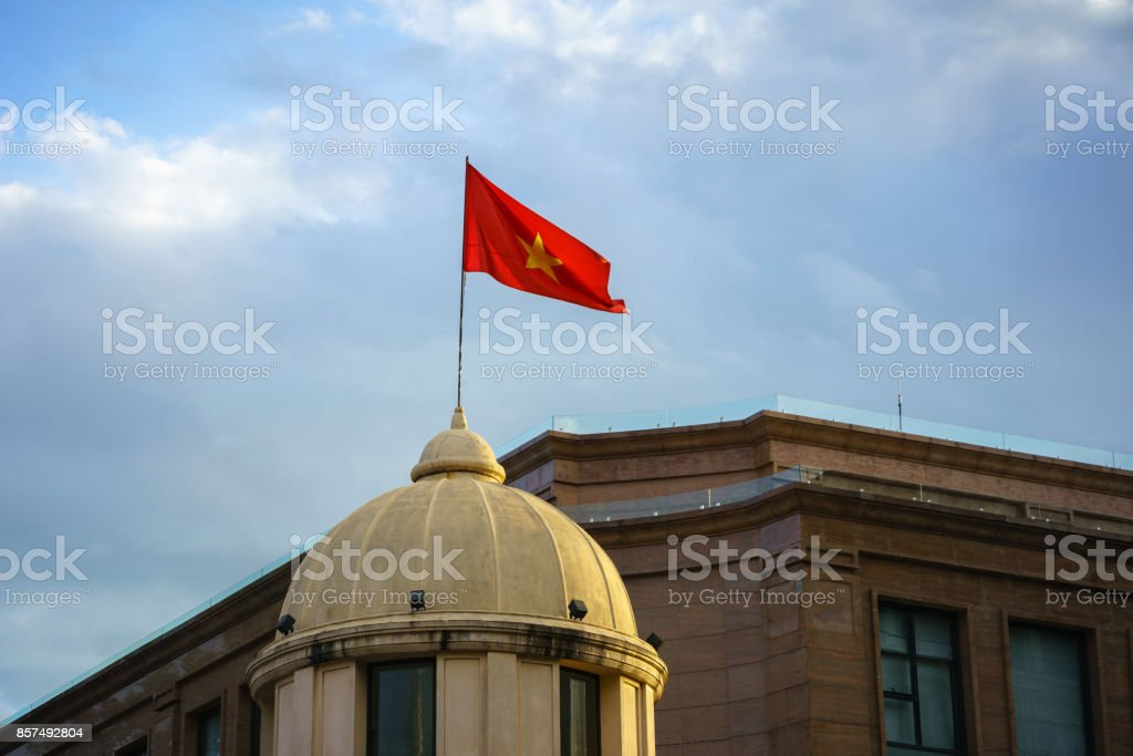 Vietnamese National Flag on top of a building stock photo