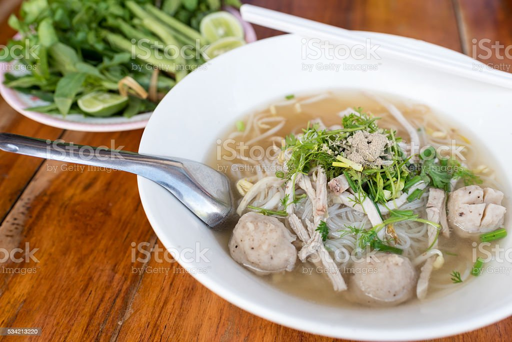 Vietnamese noodle (pho) on wooden table stock photo