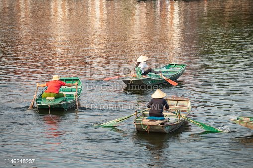 Vietnamese Paddlers paddling with their foots on boat Tam coc Ninh Binh Vietnam April,04,2019