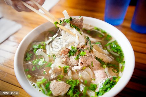 Vietnamese Pho Noodle Soup with variety of meat and vegetables.