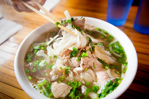 Vietnamese Pho Noodle Soup Dish Vietnamese Pho Noodle Soup with variety of meat and vegetables. rice noodles stock pictures, royalty-free photos & images
