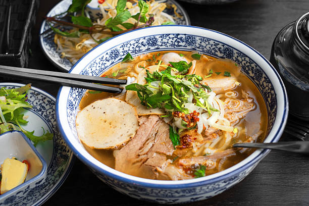 vietnamese pho tom yum - asian soup - pho soup stock photos and pictures
