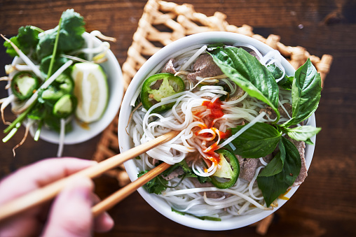 Vietnamese Pho With Spicy Sriracha Sauce Shot Top Down Stock Photo - Download Image Now