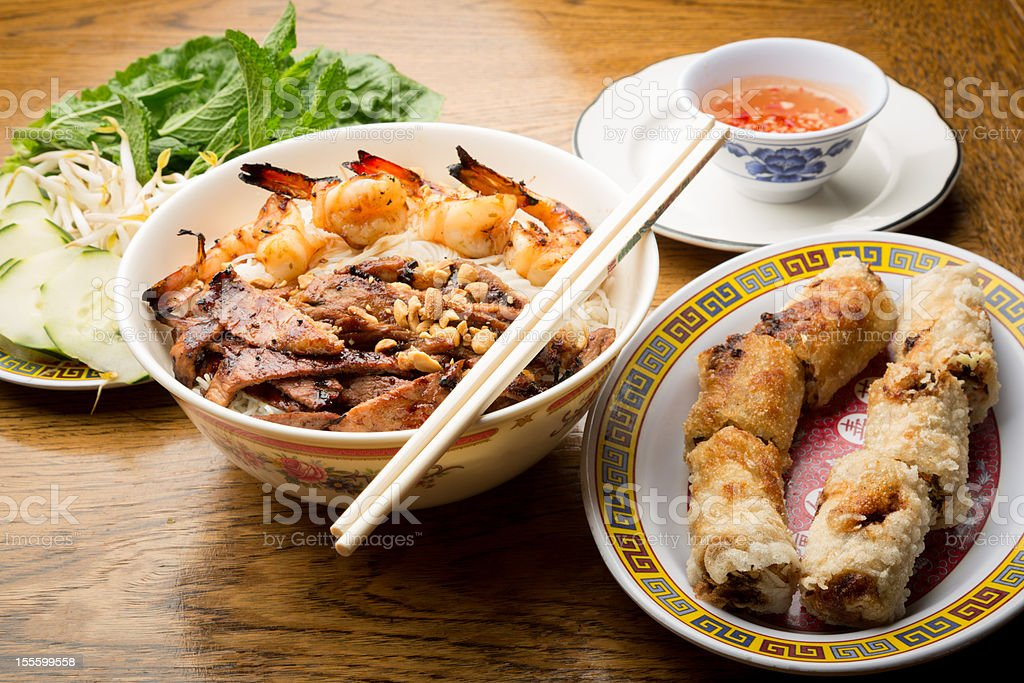 Vietnamese Pork and Shrimp Noodle Bowl with Egg Rolls royalty-free stock photo