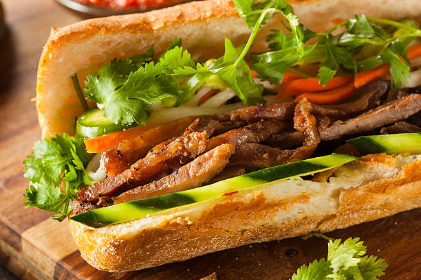 Vietnamese Pork Banh Mi Sandwich Vietnamese Pork Banh Mi Sandwich with Cilantro and Daikon bánh mì sandwich stock pictures, royalty-free photos & images