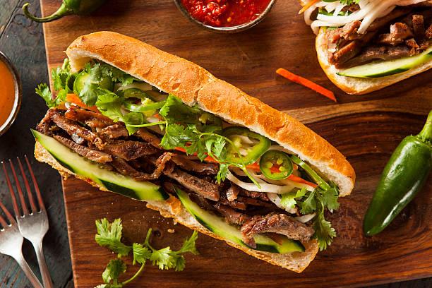 Vietnamese Pork Banh Mi Sandwich Vietnamese Pork Banh Mi Sandwich with Cilantro and Daikon vietnamese culture stock pictures, royalty-free photos & images