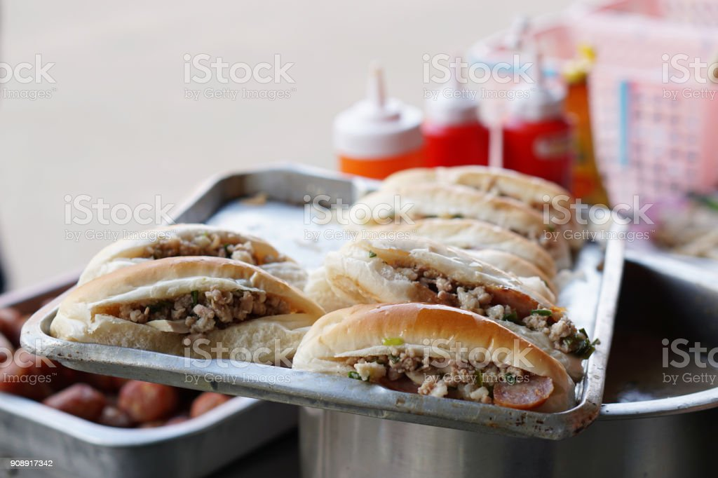 Vietnamese pork sandwich (Banh Mi) stuffed with minced pork and sausage, Traditional French baguette, one of the most popular dishes in Vietnam. stock photo