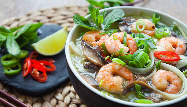 vietnamese prawn noodle soup -  pho tom yum. - pho soup stock photos and pictures