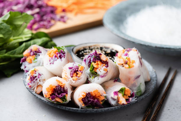 Vietnamese rice paper rolls Vietnamese rice paper rolls with shrimp, red cabbage, carrot and rice noodles. Asian cuisine food. Spring rolls vietnamese culture stock pictures, royalty-free photos & images