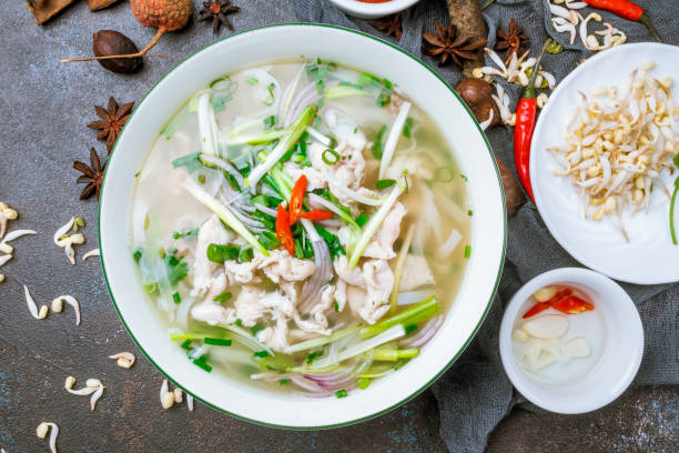 vietnamese soup pho ga - pho soup stock photos and pictures