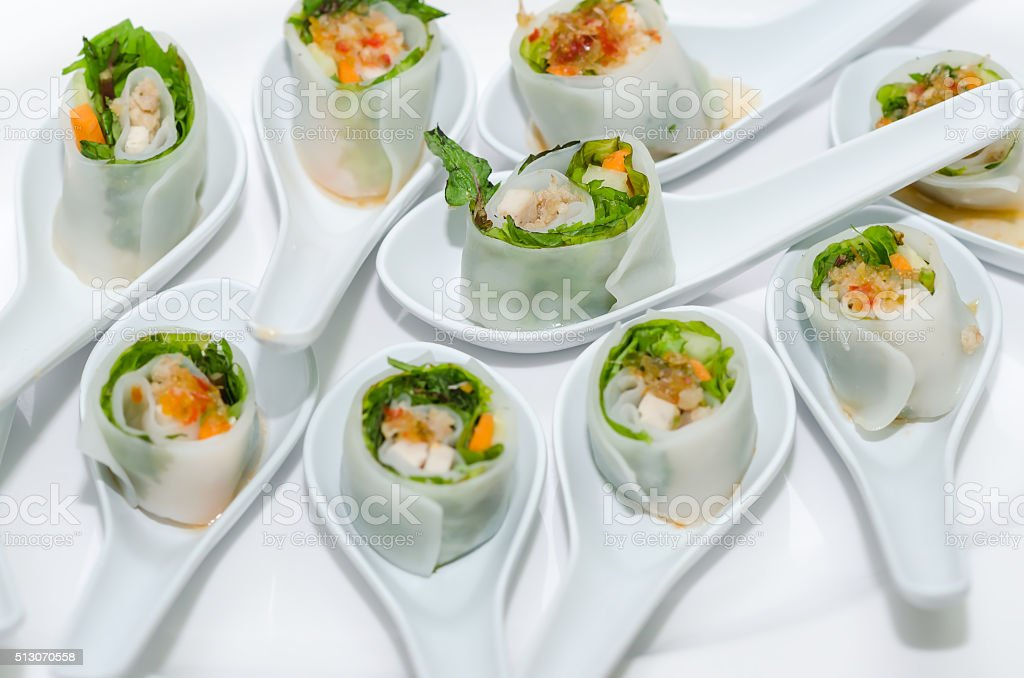 Vietnamese spring roll with herbs. stock photo
