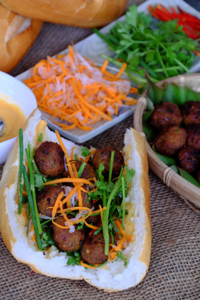 Vietnamese street food, banh mi thit nuong Vietnamese street food, banh mi thit nuong or Vietnam bread from grilled meat, this is popular eating and special culture in Viet Nam cuisine bánh mì sandwich stock pictures, royalty-free photos & images
