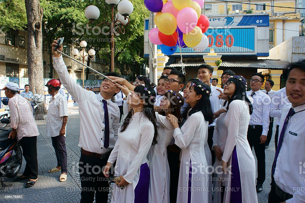 Vietnamese student, ao dai, Saigon Notre Dame Cathedral stock photo