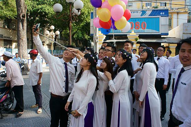 vietnamese student, ao dai, saigon notre dame cathedral - ao dai stock photos and pictures