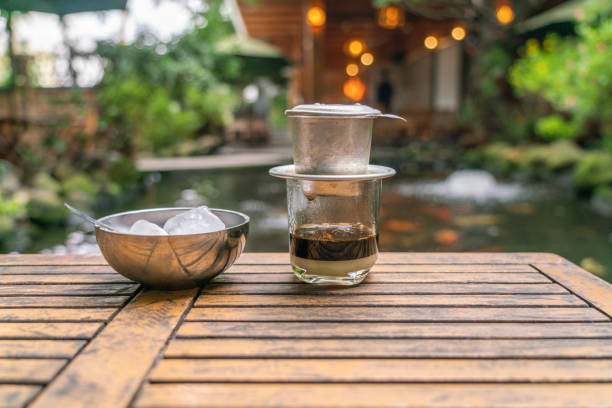 Vietnamese style coffee with fish tank background Vietnamese style coffee with fish tank background vietnamese culture stock pictures, royalty-free photos & images