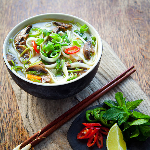 vietnamese vegan vegetarian noodle soup -  pho tom . - pho soup stock photos and pictures
