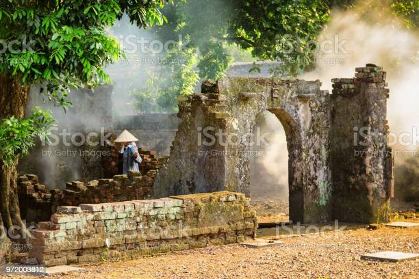 Vietnamese Woman Among Ruins Of Old Buildings Hue Vietnam Stock Photo - Download Image Now