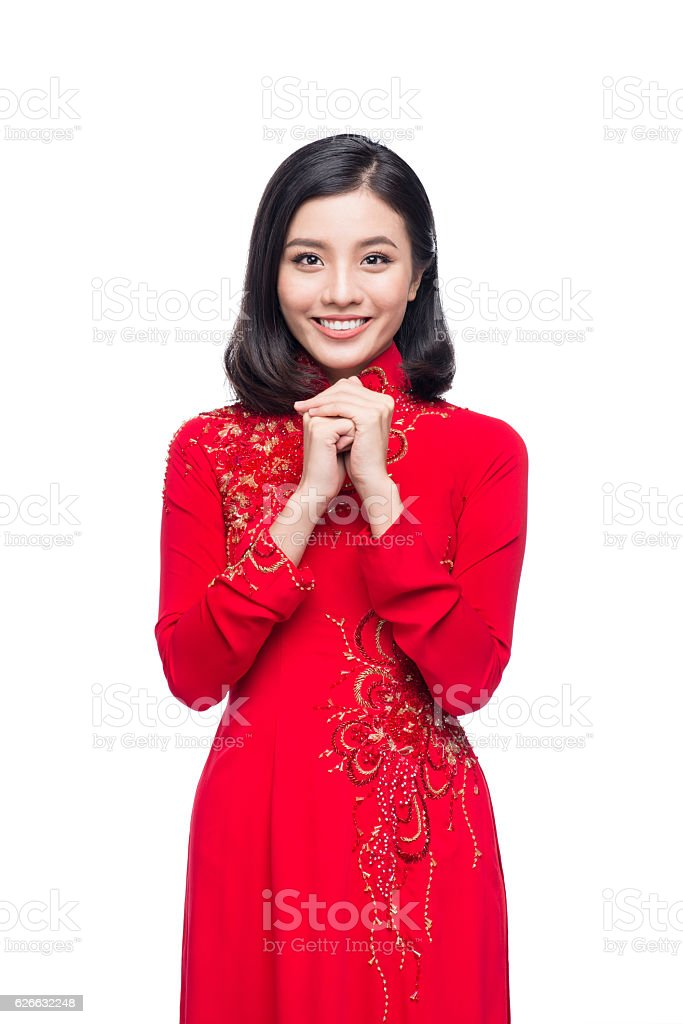 Vietnamese woman in ao dai dress with praying gesture wish stock vietnamese woman in ao dai dress with praying gesture wish royalty free stock photo m4hsunfo Choice Image
