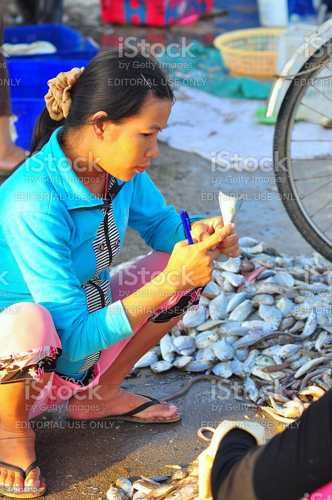 Vietnamese woman is selling her fish stock photo