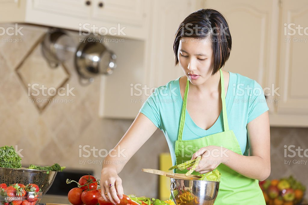 Vietnamese woman preparing healthy meal for family royalty-free stock photo